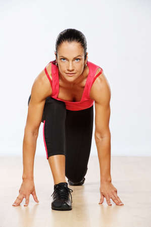 fitness club: Beautiful woman exercising in fitness club. Stock Photo