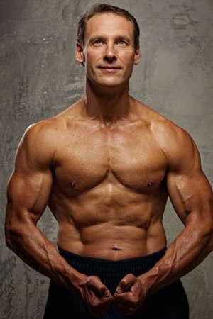 Handsome muscular man. photo