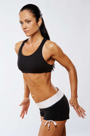 vertical wellness: Beautiful woman doing fitness exercise.