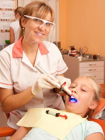dental hygienist: Teenage girl at the dentist. Stock Photo