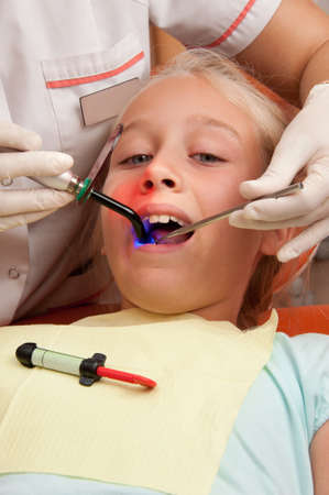 dent: Teenage girl at a dentist. Stock Photo