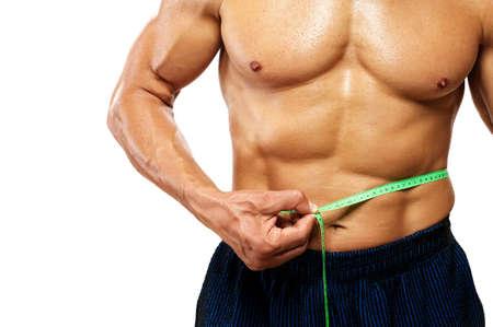 허리의 잘룩 한 선: 그의 허리의 잘록한 곳을 측정하는 사람 (남자).