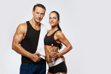 drinks after work: Athletic man and woman after fitness exercise