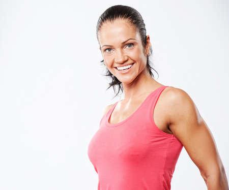 Portrait of a beautiful athlete woman. Stock Photo - 10275316