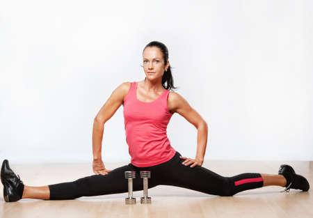 Beautiful athlete woman doing splits.  Stock Photo