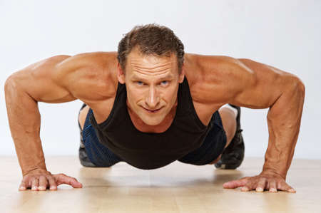 weight weightlifting: Handsome muscular man doing push-up.