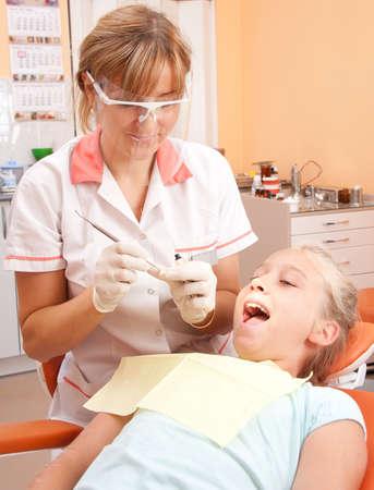 Teenage girl at a dentist. photo