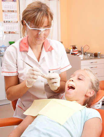 hand over: Teenage girl at a dentist. Stock Photo