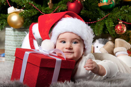 Little boy with a gift box. Stock Photo - 10467393
