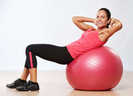 fit ball: Beautiful athlete woman with a fitness ball.