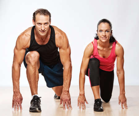 muscular man: Athletic man and woman doing fitness exercise