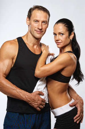 after work: Beautiful athletic couple after training. Stock Photo