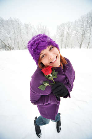 snow flowers: Funny girl with a red rose.
