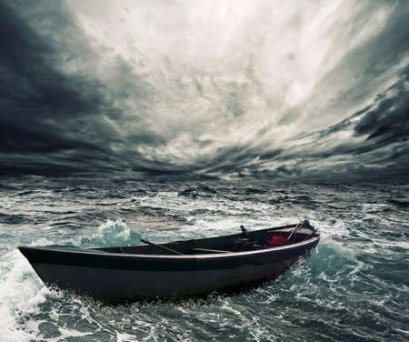 fisherman on boat: Abandoned boat in stormy sea