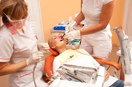 mouth cavity: Woman at the dentists surgery.