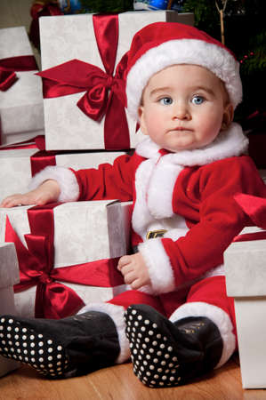 Little boy with a gift boxes. photo