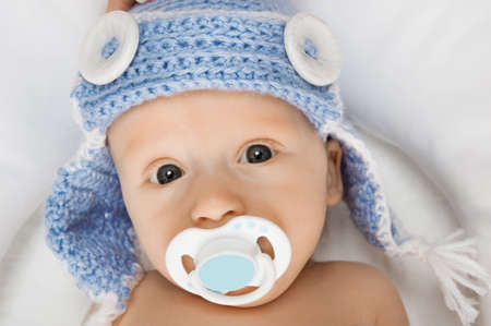 teat: Cute baby with a pacifier.