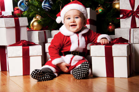 Little boy with gift boxes. photo