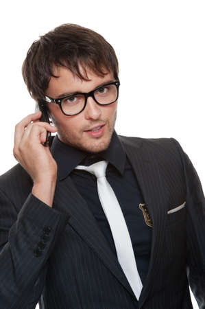 Handsome young man talking on a phone. photo
