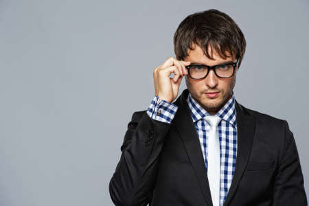 man glasses: Handsome  young man wearing glasses.
