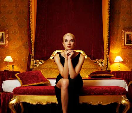 luxury bed: Beautifiul woman in luxury interior. Stock Photo