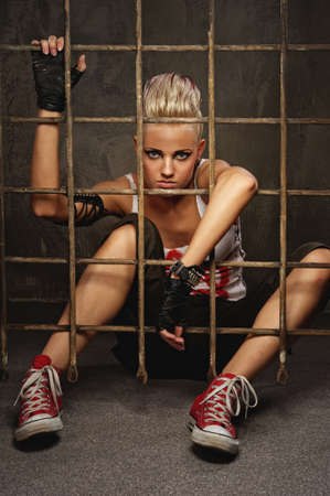 anarchy: Punk girl behind bars Stock Photo