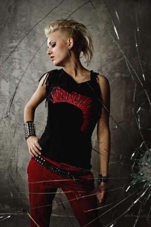Punk girl behind broken glass photo