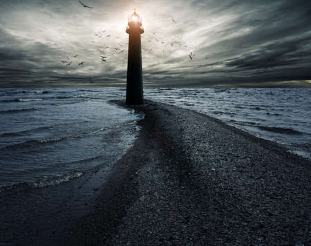 beacon light: Stormy sky over lightouse Stock Photo