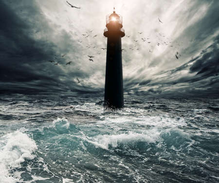 storm sea: Stormy sky over flooded lighthouse