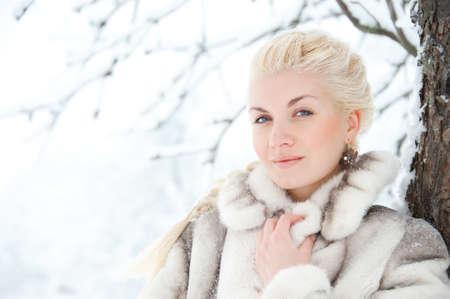 Attractive blond woman in fur coat. photo