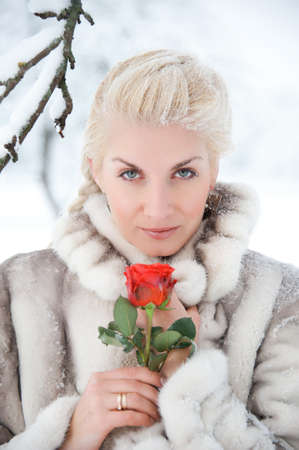 Attractive blond woman with a red rose Stock Photo - 10994546