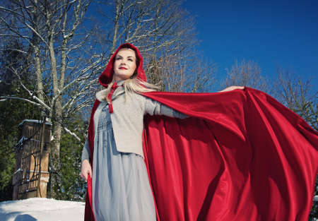 Red Hood with a waving cloak Stock Photo - 10989385
