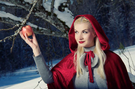Red Hood holding an apple. Stock Photo - 10994477