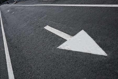 Drawn arrow on a lane. photo