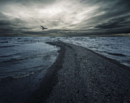 cloudy moody: Stormy sky over dark sea.