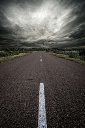 storm clouds: Road and a stormy sky.