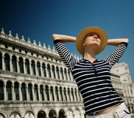 Beautiful woman in hat against Dodges Palace photo