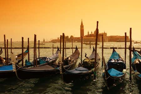 sculling: Gondolas against Venice panorama
