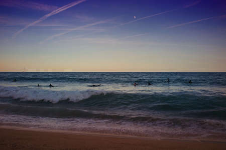 People swimming in evening sea. photo