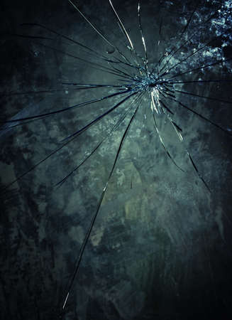 Broken glass over grey background. photo