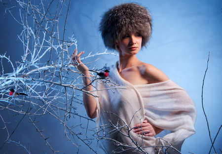 Attractive woman in winter forest photo
