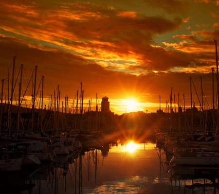dinghies: Yachts & boats in a harbour on dusk. Stock Photo