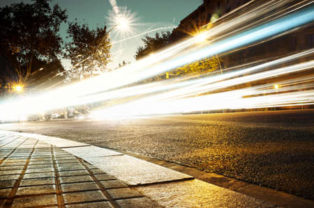 city lights: Fast moving cars at night time Stock Photo