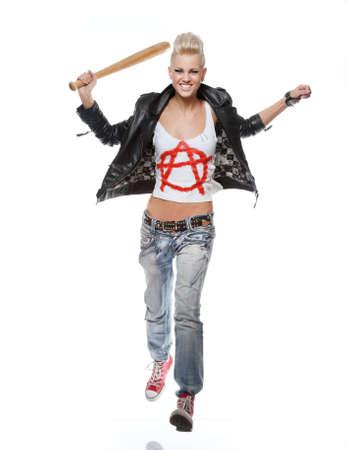 Punk girl with a baseball bat running. photo