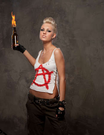 Punk girl with a Molotov cocktail photo