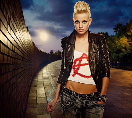 punk rock: Punk girl with cigarette outdoor