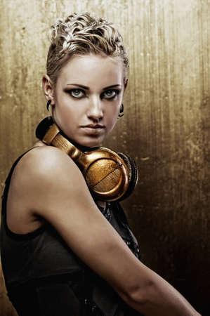 sexy headphones: Portrait of an attractive steam punk girl with headphones