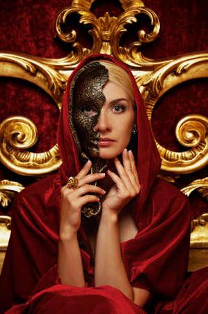 masquerade masks: Beautiful woman with a carnival mask Stock Photo