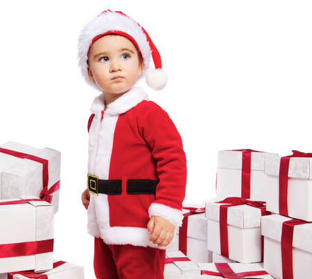 santa clause: Baby boy in Santa Claus costume standing