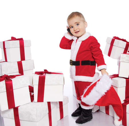 Baby boy in Santa Claus costume  with mobile phone photo